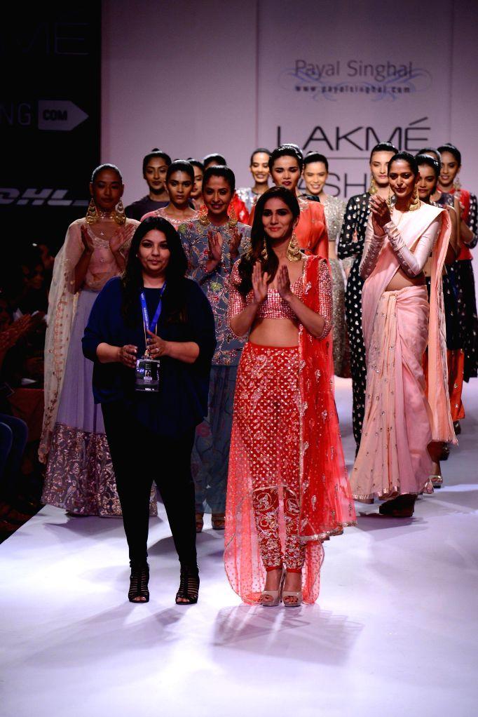 Actor Vaani Kapoor walks on the ramp with fashion designers Payal Singhal during her show at Lakme Fashion Week (LFW) Winter/ Festive 2014 in Mumbai, on Aug. 23, 2014. - Vaani Kapoor