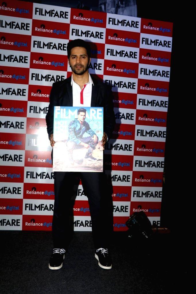 Actor Varun Dhavan during the launch of Filmfare August 2016 cover issue, in Mumbai on Aug 1, 2016. - Varun Dhavan