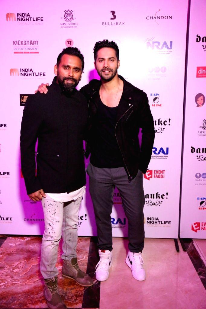 Actor Varun Dhawan and choreographer Bosco Martis during the India Nightlife Convention Awards in Mumbai on Sept 26, 2016. - Varun Dhawan