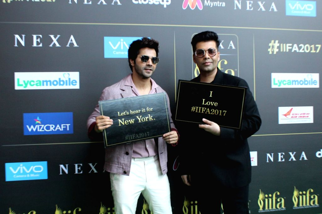Actor Varun Dhawan and film director Karan Johar during the press conference of 18th International Indian Film Academy (IIFA) awards in Mumbai, on June 18, 2017. - Varun Dhawan and Karan Johar