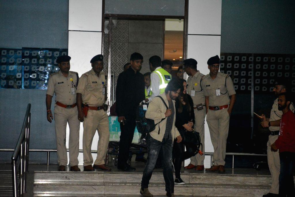 Actor Varun Dhawan and Natasha Dalal seen at Mumbai's airport on Dec 9, 2018. - Varun Dhawan