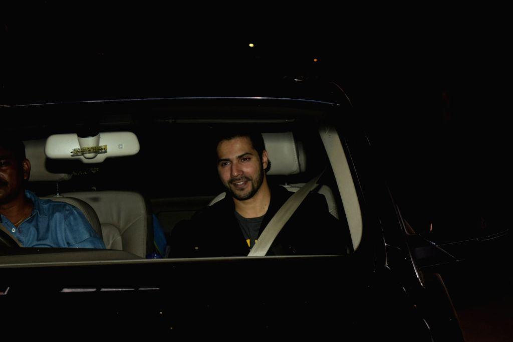 Actor Varun Dhawan arrives to attend designers Abu Jani and Sandeep Khosla's party in Mumbai on Dec 9, 2017. - Varun Dhawan