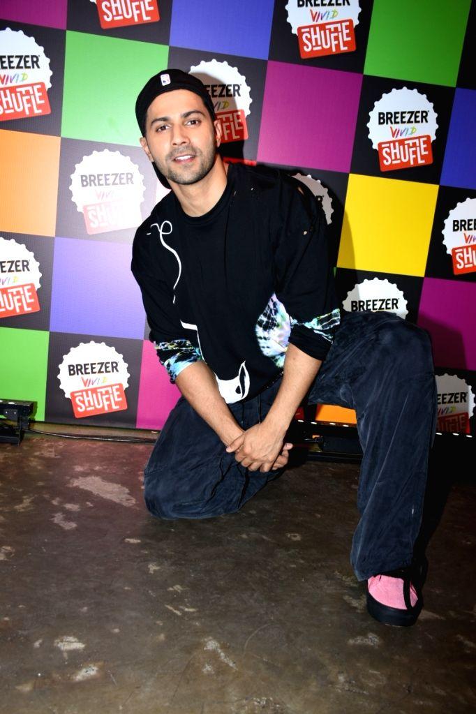 Actor Varun Dhawan at the ''Breezer Vivid Shuffle 3'' programme, in Mumbai on June 12, 2019. - Varun Dhawan