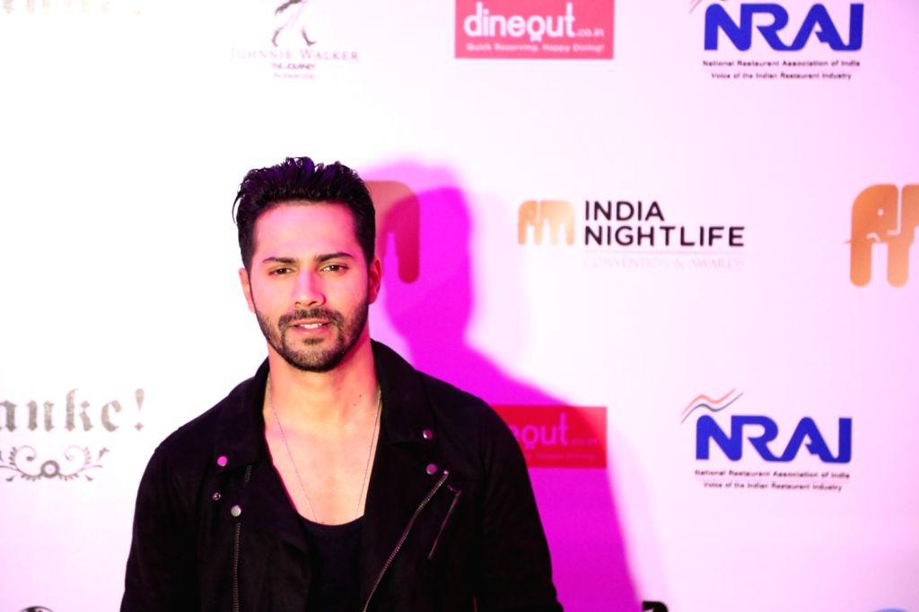 Actor Varun Dhawan during the India Nightlife Convention Awards in Mumbai on Sept 26, 2016. - Varun Dhawan