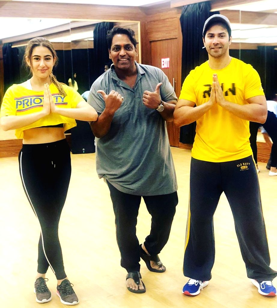 "Actor Varun Dhawan has funnily accused his ""Coolie No. 1"" co-actor Sara Ali Khan of copying the colour of his clothes. On Monday morning, Varun Dhawan shared a photograph on Instagram where ... - Varun Dhawan and Sara Ali Khan"