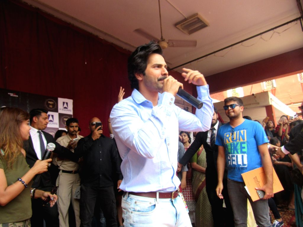 "Actor Varun Dhawan interacts with the students during the promotion of his upcoming film ""October"" at Lakshmibai College in New Delhi on April 5, 2018. - Varun Dhawan"