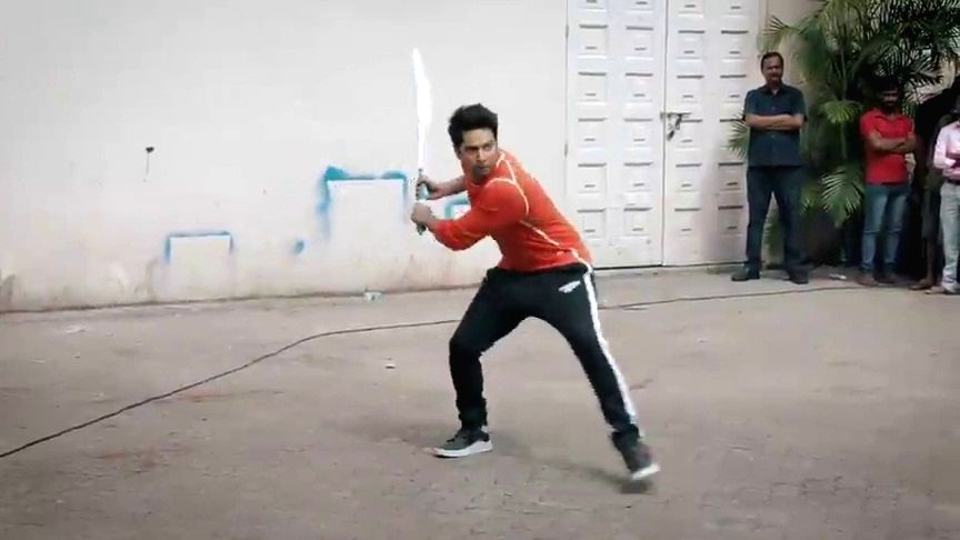 Actor Varun Dhawan plays cricket with cricket legend Sachin Tendulkar. - Varun Dhawan and Sachin Tendulkar