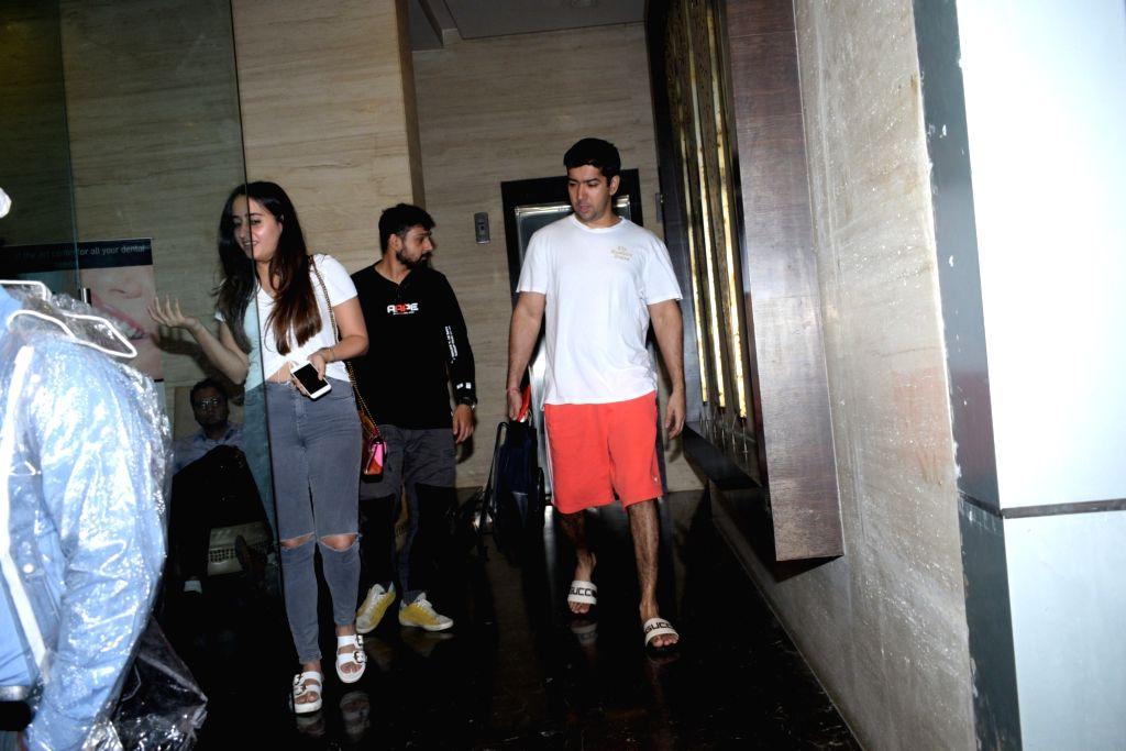 Actor Varun Dhawan's brother Rohit Dhawan and her girlfriend Natasha Dalal seen at the actor's office at Juhu, Mumbai on June 14, 2019. - Varun Dhawa