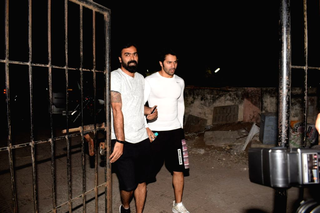 Actor Varun Dhawan seen at director Shoojit Sircar (left) office in Mumbai on Feb 1, 2018. - Varun Dhawan