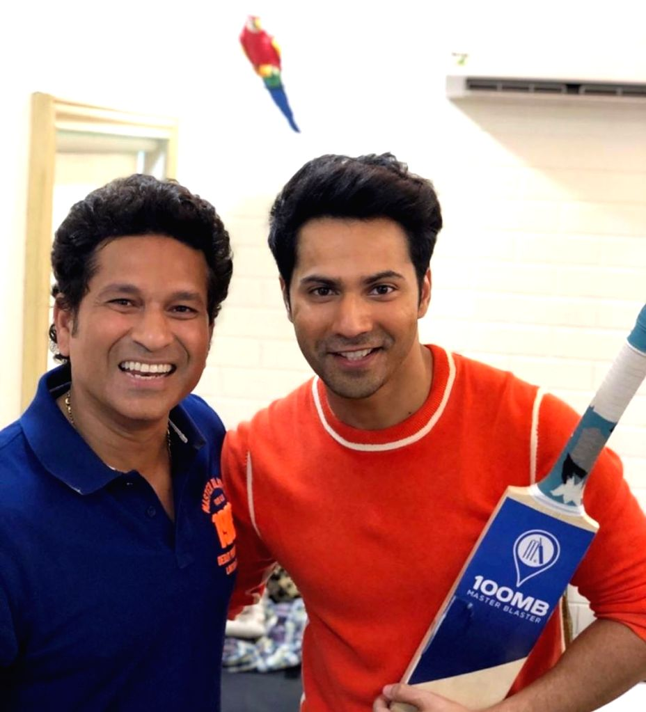 Actor Varun Dhawan with Cricket legend Sachin Tendulkar. - Varun Dhawan and Sachin Tendulkar