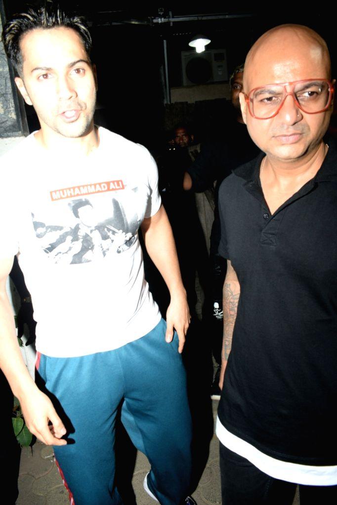 Actor Varun Dhawan with hair stylist Hakim Aalim in Andheri on May 14, 2019. - Varun Dhawan