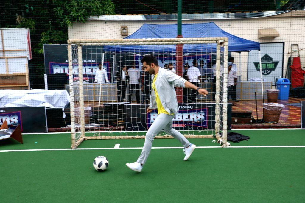 "Actor Varun Mitra plays football during a press conference regarding his upcoming web series ""Bombers"" in Mumbai on June 14, 2019. - Varun Mitra"