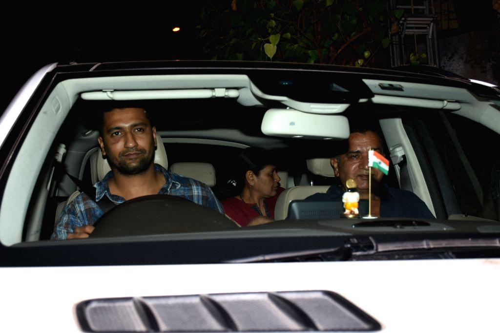 Actor Vicky Kaushal with his parents Sham Kaushal and Veena Kaushal, seen in Mumbai's Bandra, on May 8, 2019. - Vicky Kaushal