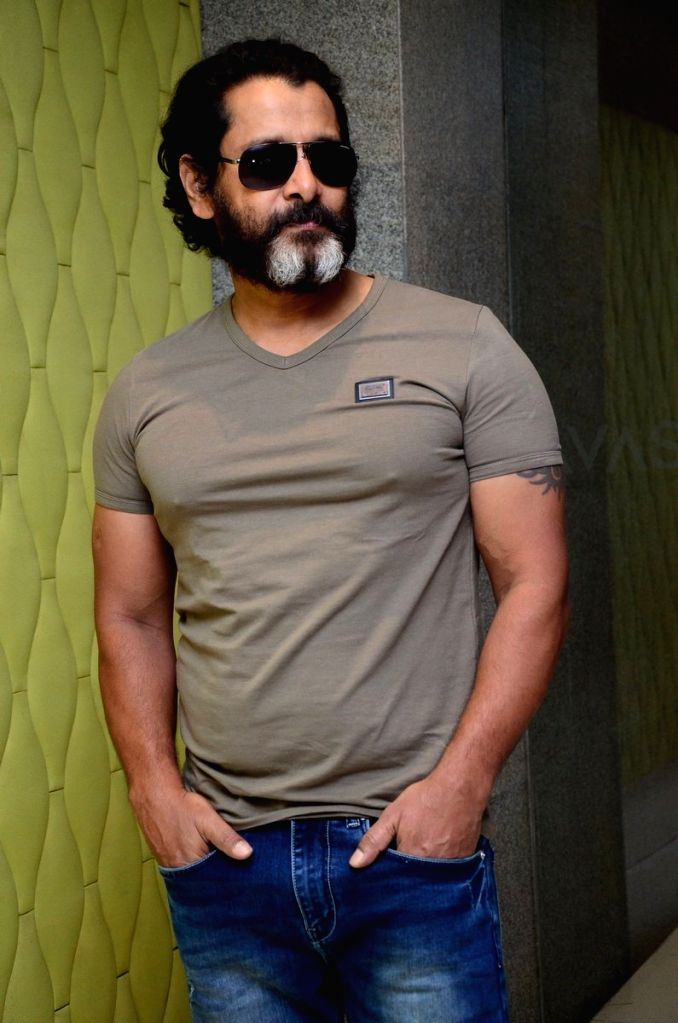 "Actor Vikram during a photo shoot at a media interaction for his upcoming Telugu film ""Mr.KK"" in Hyderabad. - Vikram"