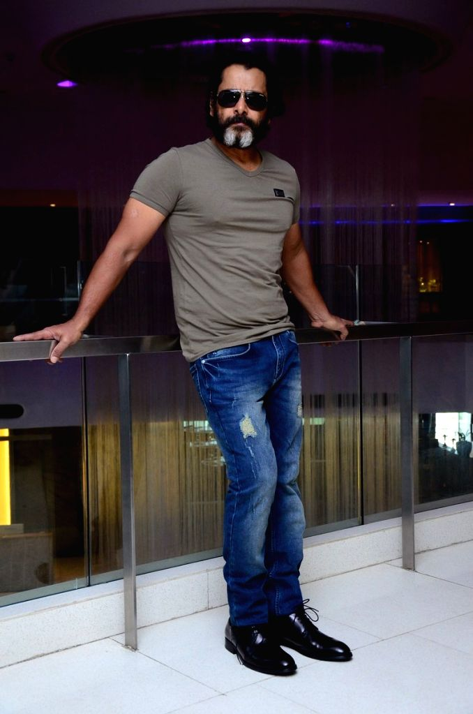"""Actor Vikram during a photo shoot at a media interaction for his upcoming Telugu film """"Mr.KK"""" in Hyderabad. - Vikram"""