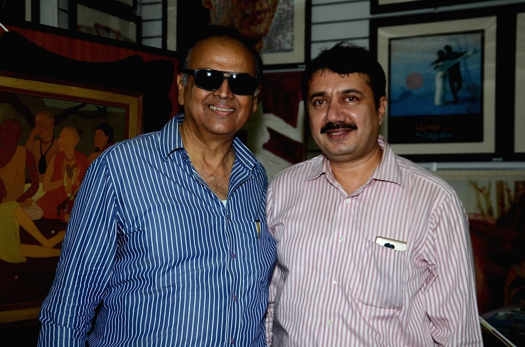 Actor Vikram Makandar and film historian SMM Ausaja  during the opening preview of The Osian Group`s The Greatest Indian Show on Earth 2, in Mumbai on June 16, 2017. - Vikram Makandar
