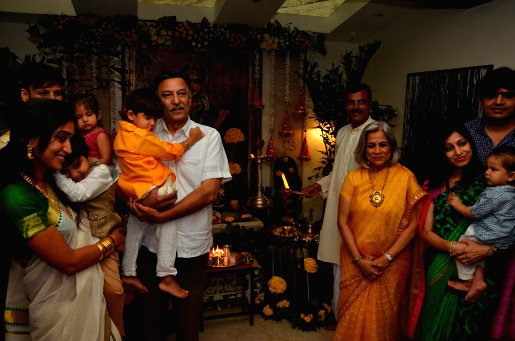 Actor Vivek Oberoi along with his wife Priyanka Alva Oberoi children Vivaan Veer Oberoi and Ameyaa Nirvana Oberoi participates in a procession for the immersion of an idol of the ... - Vivek Oberoi