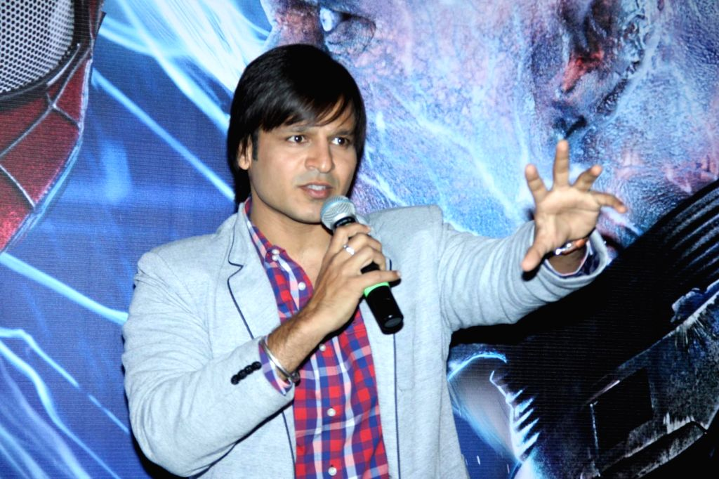 Actor Vivek Oberoi meets Spiderman at PVR, in Mumbai, on April 18, 2014.