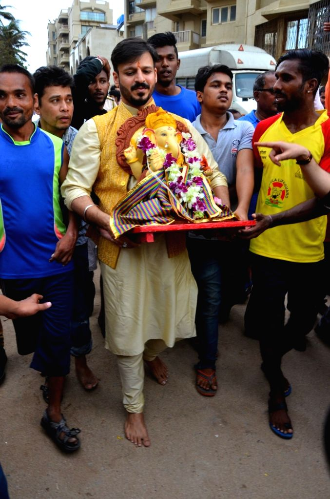 Actor Vivek Oberoi participates in a procession for the immersion of an idol of the elephant-headed Hindu god Lord Ganesh on the fifth day to the Arabian Sea in Mumbai on Sept. 9, 2016. - Vivek Oberoi