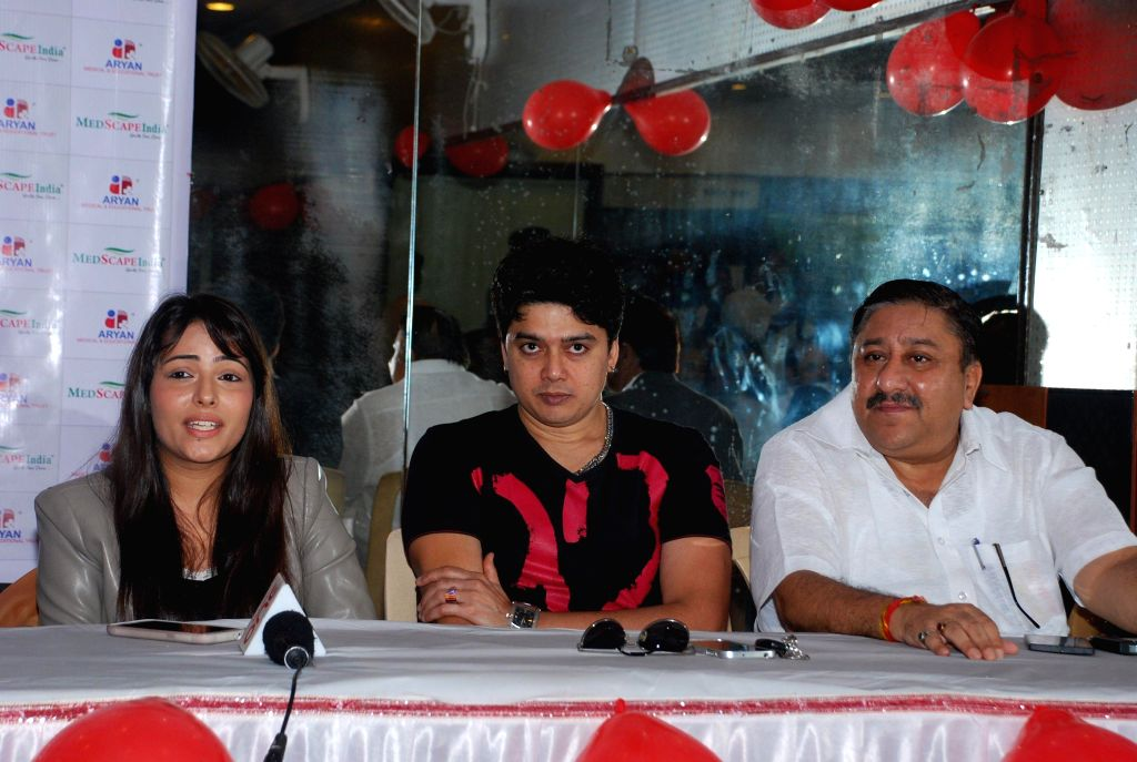Actors Aanchal Munjal and Harish Kumar for AIDS awareness while celebrating World AIDS Day in Mumbai on Dec 1, 2014. - Aanchal Munjal and Harish Kumar