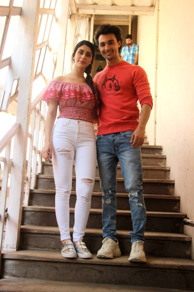 """Actors Aayush Sharma and Warina Hussain at the promotion of their upcoming film """"Loveratri"""" in Mumbai on Sept 11, 2018. - Aayush Sharma and Warina Hussain"""