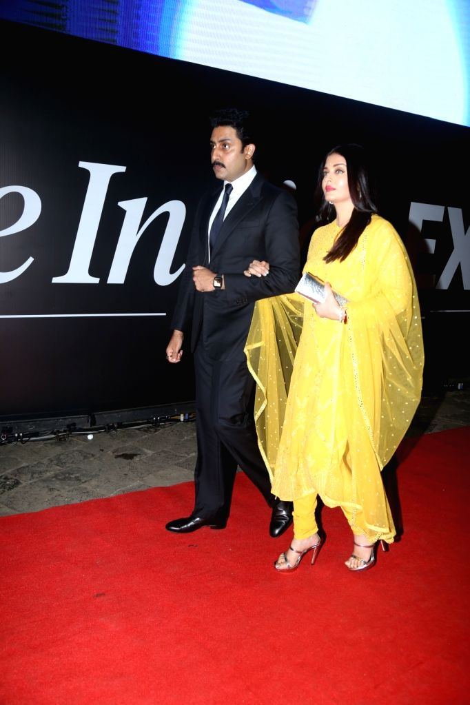 Actors Abhishek Bachchan and his wife Aishwarya Rai Bachchan during a function to pay homage to 26/11 victims at Gateway of India,in Mumbai on Nov 26, 2019. - Abhishek Bachchan and Aishwarya Rai Bachchan