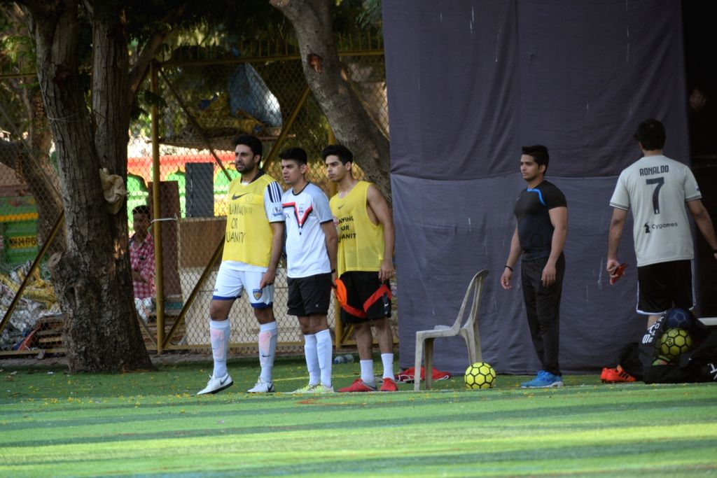 Actors Abhishek Bachchan and Ishaan Khattar during a football match in Mumbai's Juhu, on April 14, 2019. - Abhishek Bachchan and Ishaan Khattar