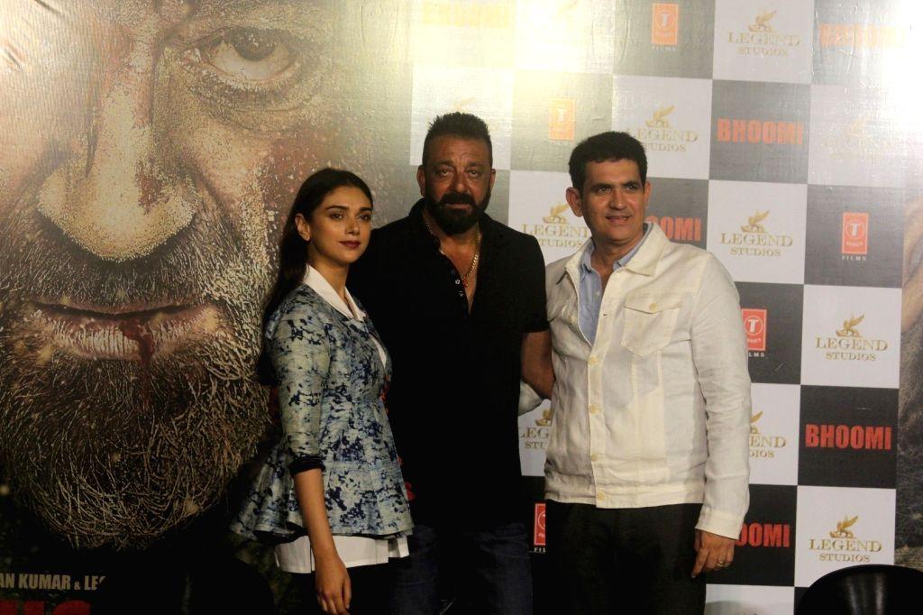 "Actors Aditi Rao Hydari and Sanjay Dutt along with Film Director Omung Kumar during the trailer launch of their upcoming film ""Bhoomi"" in Mumbai on Aug 10, 2017. (Photo: IANS] - Aditi Rao Hydari, Sanjay Dutt and Omung Kumar"
