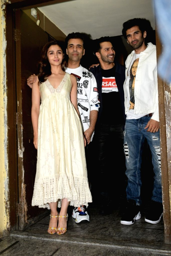 "Actors Aditya Roy Kapoor, Varun Dhawan and Alia Bhatt with producer Karan Johar at the screening of their upcoming film ""Kalank"" in Mumbai, on April 14, 2019. - Aditya Roy Kapoor, Varun Dhawan, Alia Bhatt and Karan Johar"