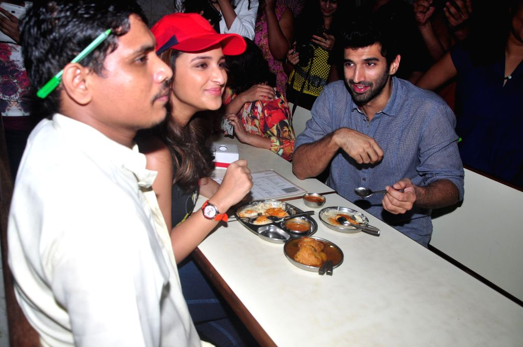 Actors Aditya Roy Kapur and Parineeti Chopra during the Flag off the Daawat-E-Ishq food yatra (road trip) to promotes their film Daawat-E-Ishq in Mumbai on Sept 12, 2014. - Aditya Roy Kapur and Parineeti Chopra