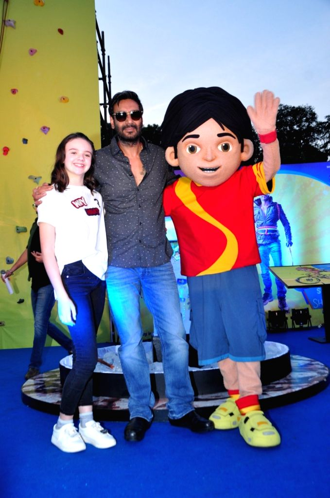 Actors Ajay Devgan and Abigail Eames during the promotion of film Shivaay in Mumbai on Oct. 29, 2016. - Ajay Devgan and Abigail Eames