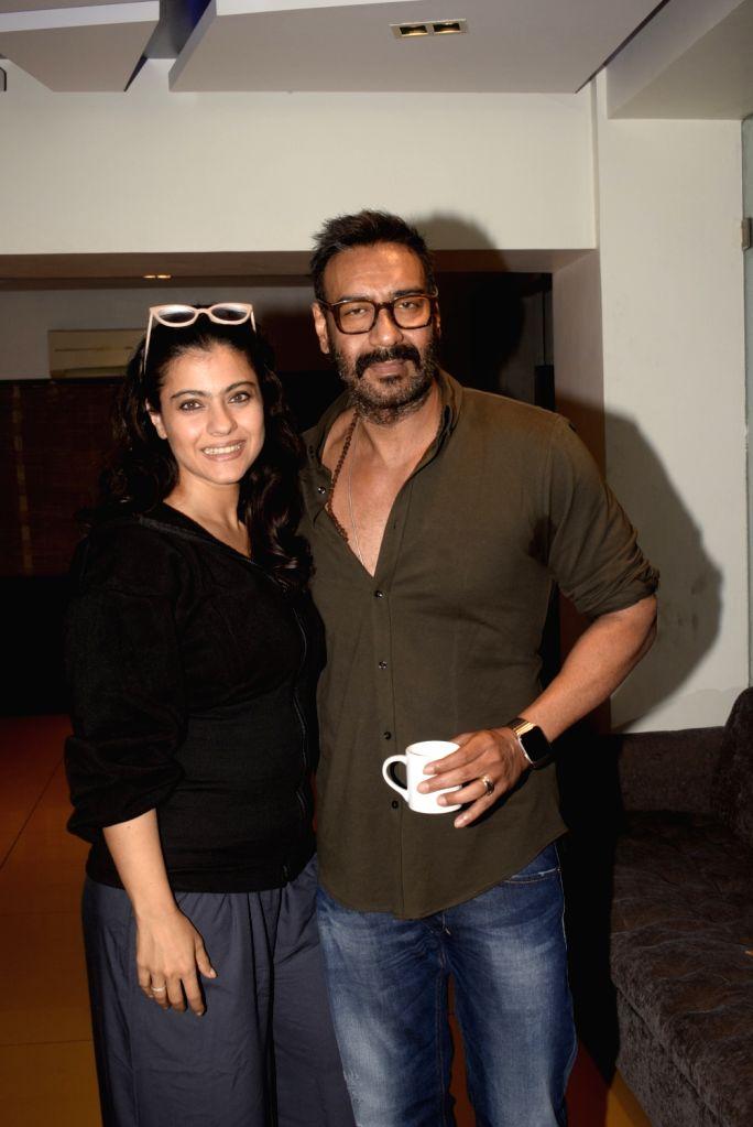 """Actors Ajay Devgan and Kajol at the screening of upcoming film """"Total Dhamaal"""" in Mumbai on Feb 21, 2019. - Ajay Devgan and Kajol"""