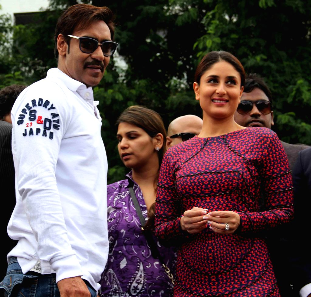 Actors Ajay Devgan and Kareena Kapoor during a promotional event organised to promote their upcoming film `Singham Returns` at a college in Banjara Hills of Hyderabad on Aug 8, 2014. - Ajay Devgan and Kareena Kapoor