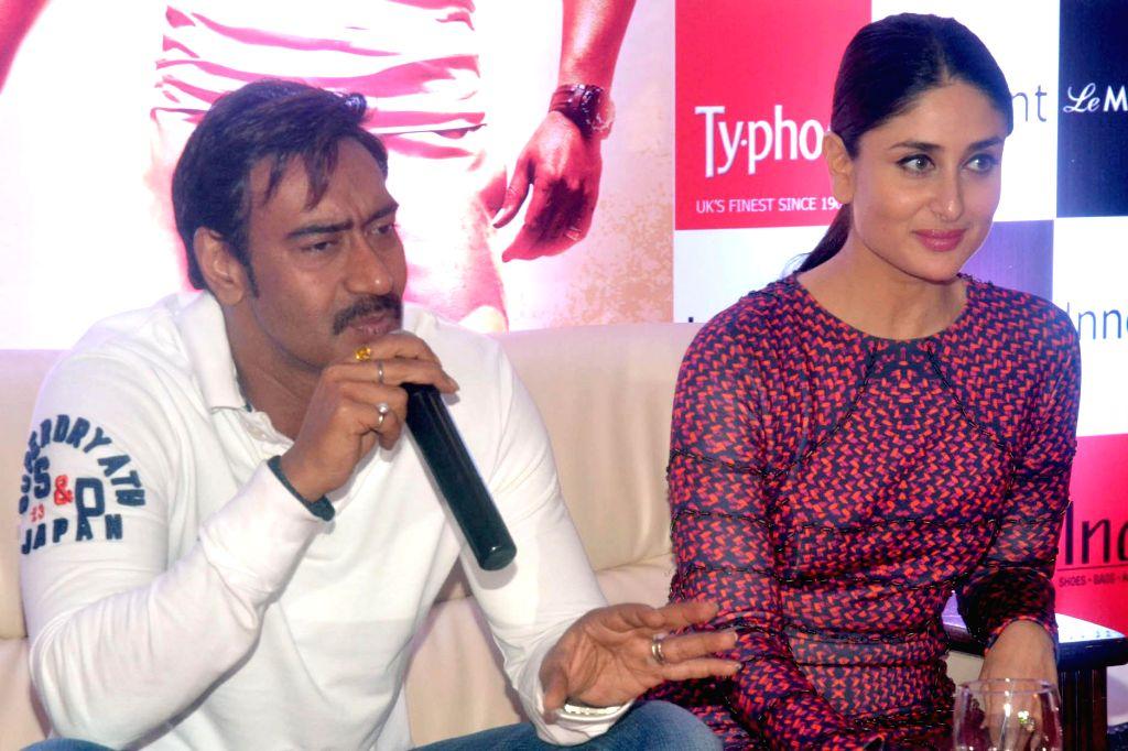 Actors Ajay Devgan and Kareena Kapoor during a press conference to promote their upcoming film `Singham Returns` in Bangalore on Aug 8, 2014. - Ajay Devgan and Kareena Kapoor