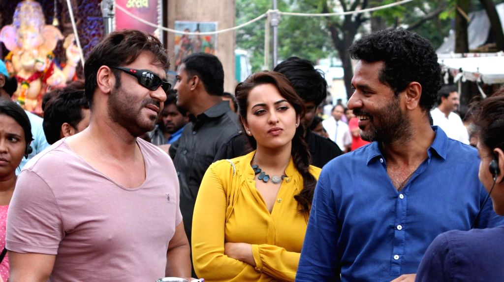 Actors Ajay Devgan, Sonakshi Sinha and Indian film actor, director and dance choreographer Prabhu Deva on the sets of their upcoming film `Action Jackson`. - Ajay Devgan, Sonakshi Sinha and Indian