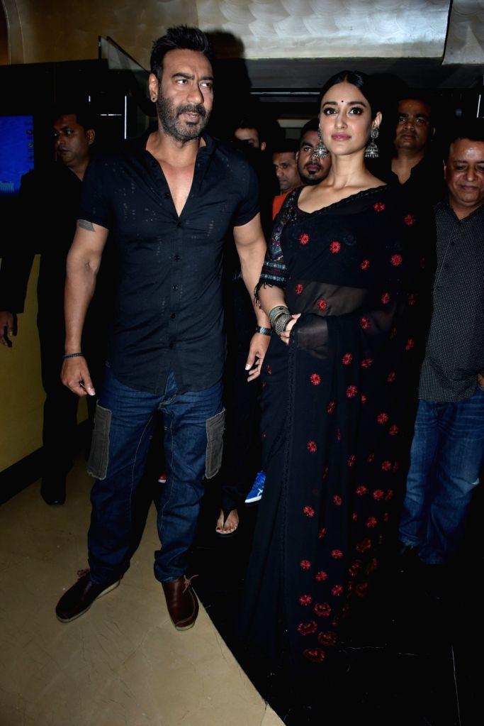"Actors Ajay Devgn and Ileana D'Cruz at the trailer launch of his upcoming film ""Raid"" in Mumbai on Feb 6, 2018. - Ajay Devgn and Ileana D'Cruz"