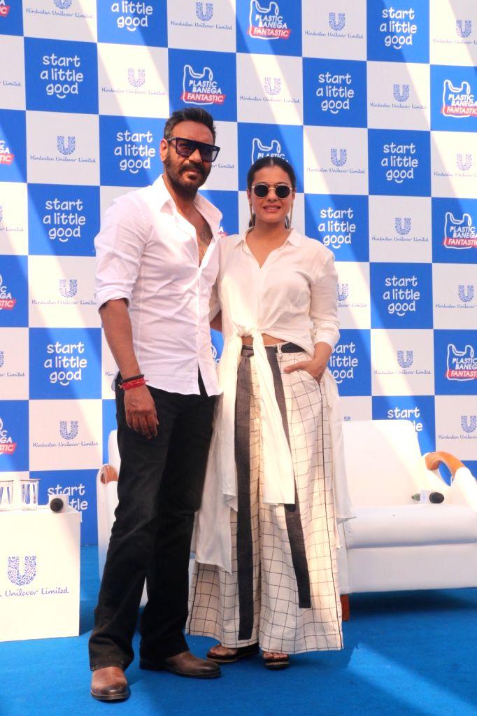"""Actors Ajay Devgn and Kajol at launch of a campaign """"Plastic Banega Fantastic"""" in Mumbai on Jan. 19, 2019. - Ajay Devgn and Kajol"""