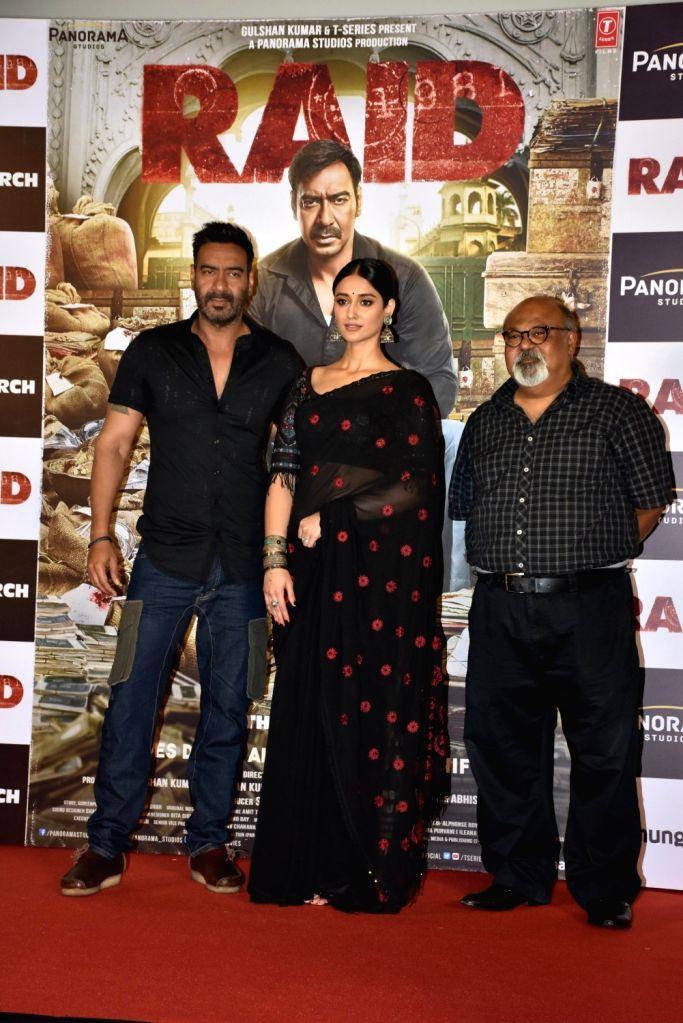 "Actors Ajay Devgn, Ileana D'Cruz and Saurabh Shukla at the trailer launch of his upcoming film ""Raid"" in Mumbai on Feb 6, 2018. - Ajay Devgn and Ileana D'Cruz"