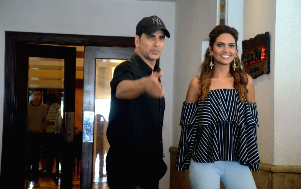 Actors Akshay Kumar and Esha Gupta during a photoshoot in Mumbai on Aug 1, 2016. - Akshay Kumar and Esha Gupta