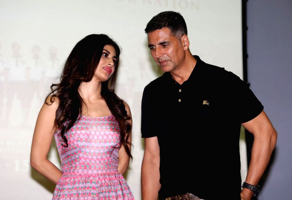 """Actors Akshay Kumar and Mouni Roy at the song launch of  their upcoming film """"Gold"""" in Kolkata on Aug 9, 2018. - Akshay Kumar and Mouni Roy"""