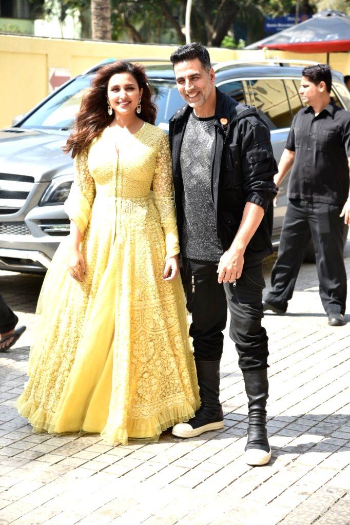 "Actors Akshay Kumar and Parineeti Chopra arrive at a press conference of their upcoming film ""Kesari"" in Mumbai, on March 15, 2019. - Akshay Kumar and Parineeti Chopra"