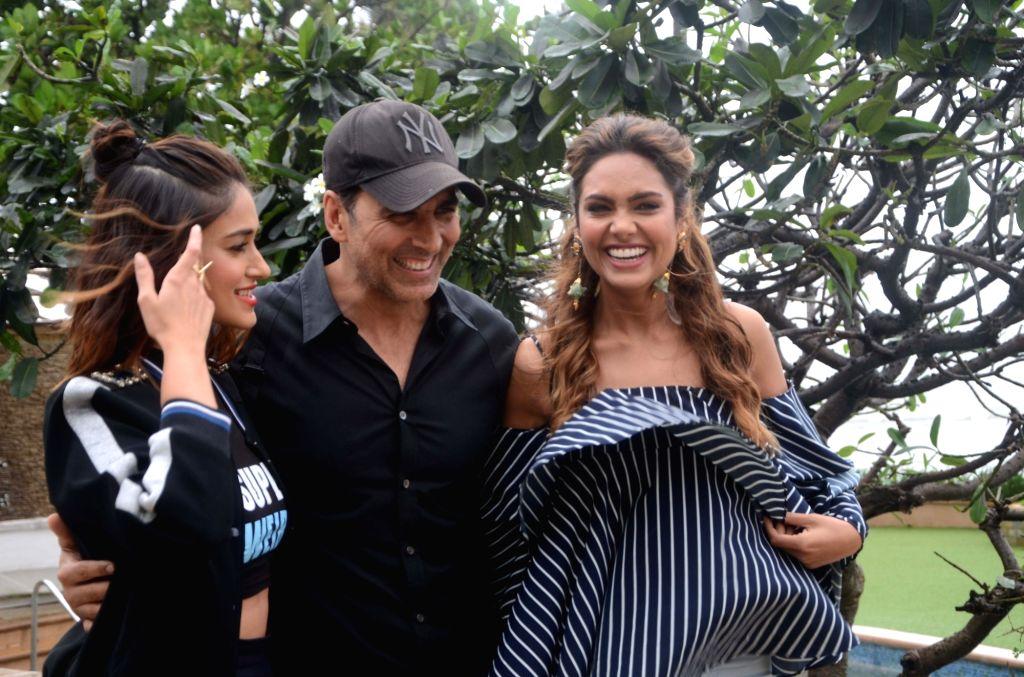 "Actors Akshay Kumar, Esha Gupta and Ilene D""Cruz during a photoshoot in Mumbai on Aug 1, 2016. - Akshay Kumar, Esha Gupta and Ilene D"