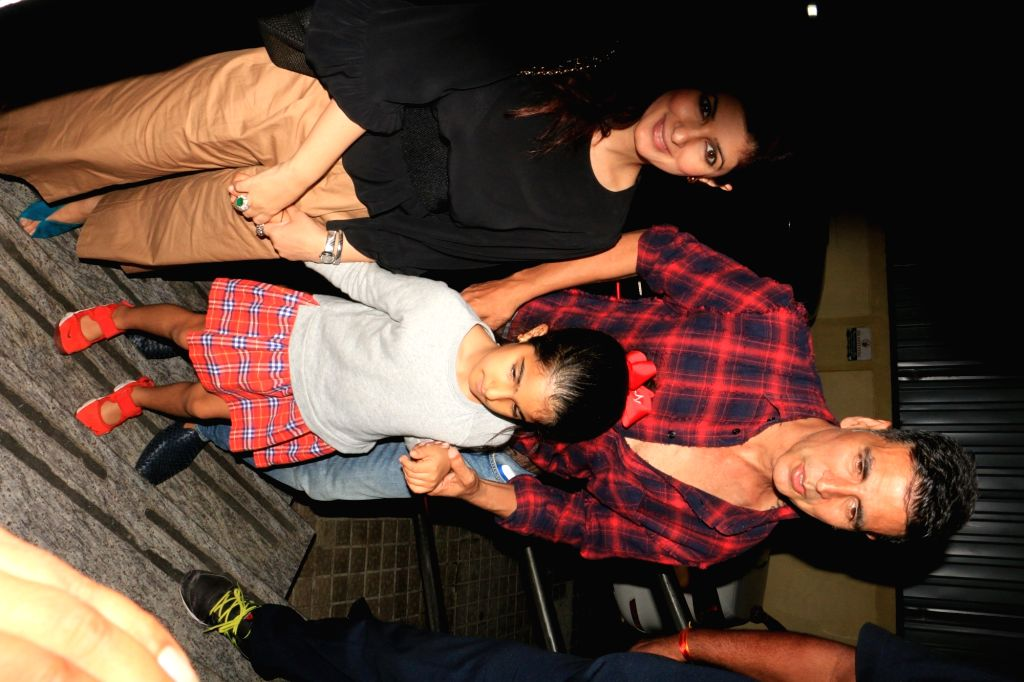 "Actors Akshay Kumar, Twinkle Khanna and their daughter Nitara Kumar arrive at the screening of the film ""Avengers: Endgame"" in Mumbai, on April 26, 2019. - Akshay Kumar, Twinkle Khanna and Nitara Kumar"