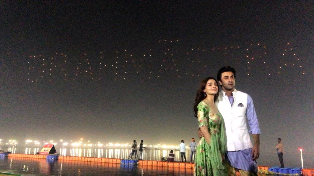 Actors Alia Bhatt and Ranbir Kapoor with a backdrop of their upcoming film 'Brahmastra' logo at Sangam - the trinity of rivers Ganga, Yamuna and the mythical Saraswati, on the occasion ... - Alia Bhatt and Ranbir Kapoor