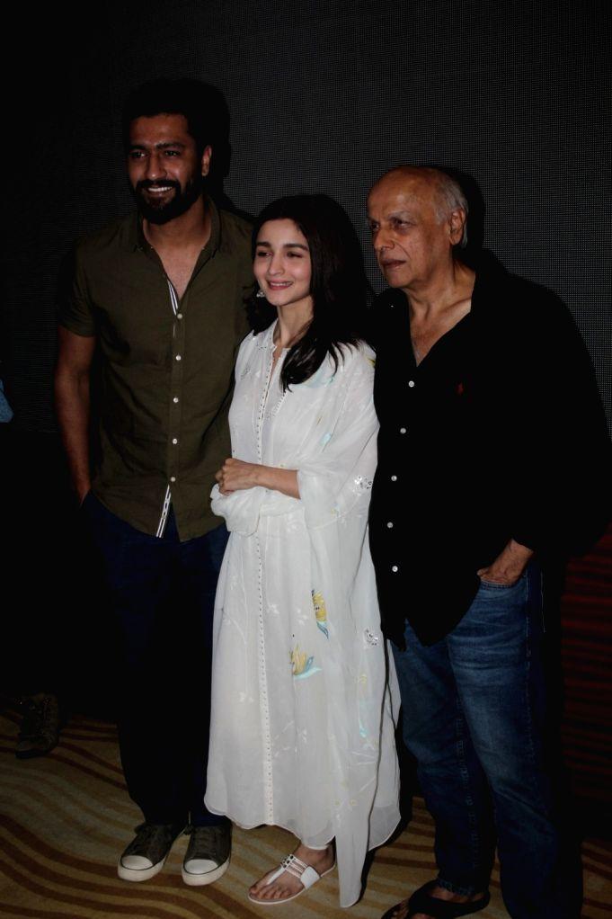 """Actors Alia Bhatt, Vicky Kaushal and filmmaker Mahesh Bhatt at the special screening of the film """"Raazi"""", in Mumbai on June 2, 2018. - Alia Bhatt and Vicky Kaushal"""