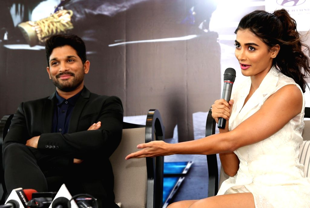 "Actors Allu Arjun and Pooja Hegde during a programme organised to promote their upcoming film ""DJ"" in Bengaluru, on June 22, 2017. - Allu Arjun and Pooja Hegde"
