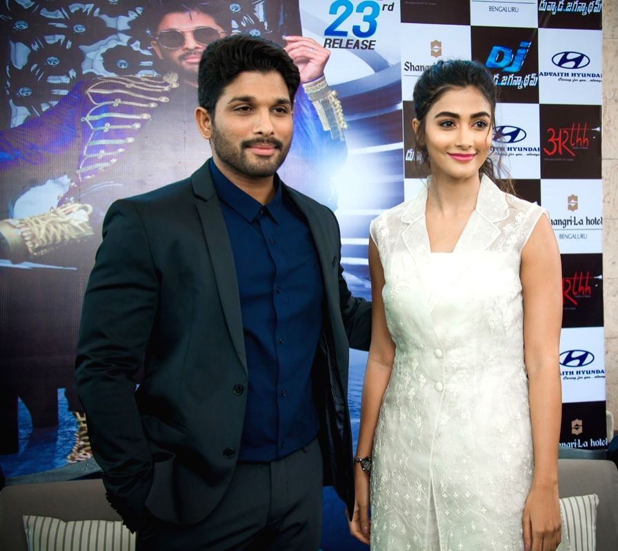 Actors Allu Arjun and Pooja Hegde during a press meet of film Duvvada Jagannadham at Bengaluru. - Allu Arjun and Pooja Hegde