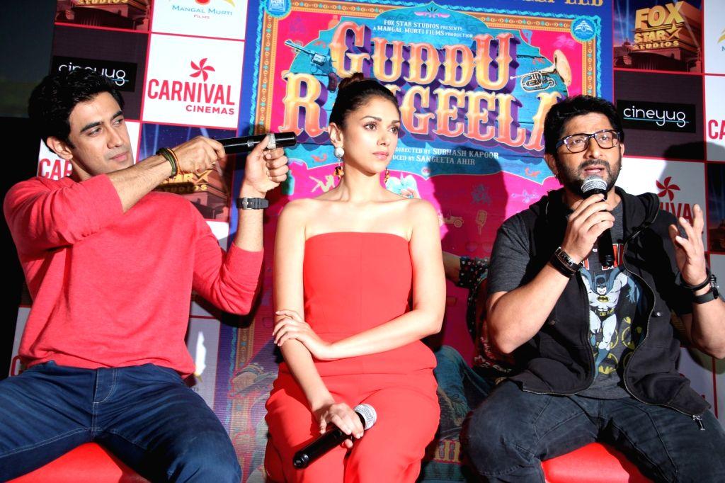 Actors Amit Sadh, Aditi Rao Hydari and Arshad Warsi during the promotion of film Guddu Rangeela at the launch of Carnival Cinemas new multiplex in Mumbai on July 2, 2015. - Amit Sadh, Aditi Rao Hydari and Arshad Warsi