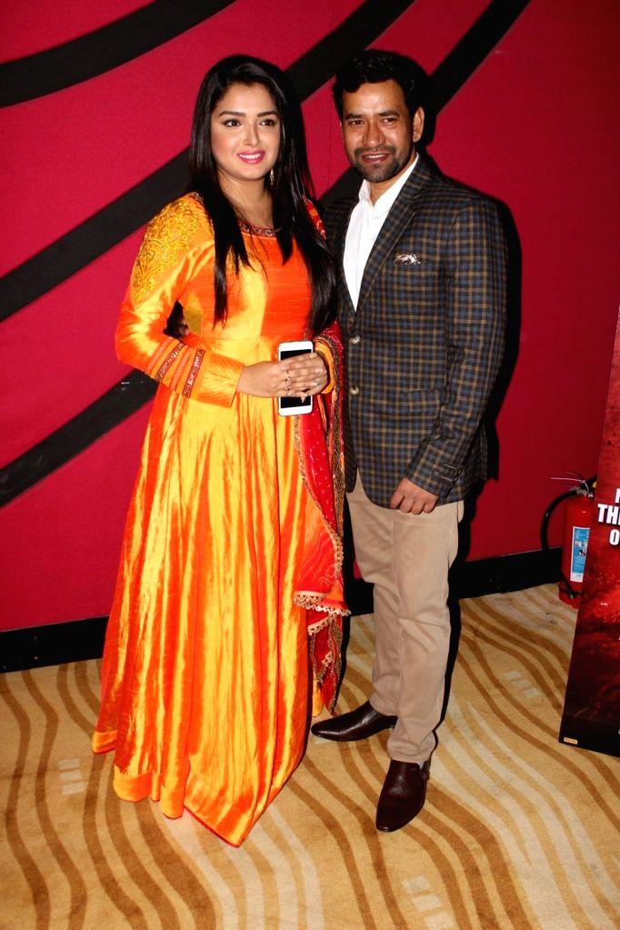 "Actors Amrapali Dubey and Dinesh Lal Yadav the trailer launch of film ""Kaashi Amarnat"" in Mumbai on Sept 16, 2017. - Amrapali Dubey and Dinesh Lal Yadav"