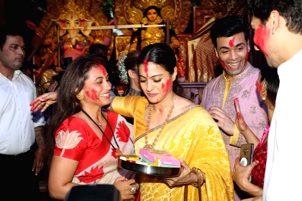 Actors and cousins Kajol and Rani Mukerji celebrate 'Sindoor Khela' on Vijaya Dashami, in Mumbai on Oct 8, 2019. - Kajol